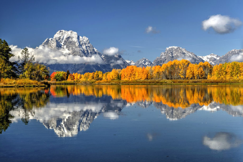 Autumn reflections along Oxbow Bend in Grand Teton National Park just after sunrise on a perfect September morning.