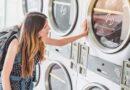 A woman washing backpack in washing machine